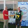 Matt Carr from Orica with winner Garry Lanham. Sample supplied from Ben Lomond Waters, Chimney Saddle Water Treatment Plant in Launceston.