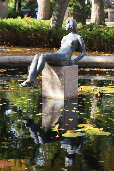 Reclining Girl Among Water Lilies