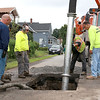 There was an early morning water main break on Chester Street in Fitchburg on Tuesday, July 25, 2017. Employees from the Cities Water Department and Sewer Department were on hand to fix the problem.  SENTINEL & ENTERPRISE/JOHN LOVE