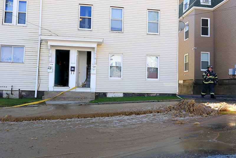 As the Fitchburg Fire Department battled a fire at 114 and 116 Laurel Street, pictured here, a water main broke and water started rushing down the street. SENTINEL & ENTERPRISE/JOHN LOVE