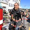 As the Fitchburg Fire Department battled a fire at 114 and 116 Laurel Street a water main broke and water started rushing down the street. Fitchburg Fire Lt.Robert DaCosta takes off his gear after helping to fight the fire. SENTINEL & ENTERPRISE/JOHN LOVE