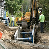 Leominster is working on replacing the water main under the Lindell Street bridge Wednesday morning. SENTINEL & ENTERPRISE/JOHN LOVE