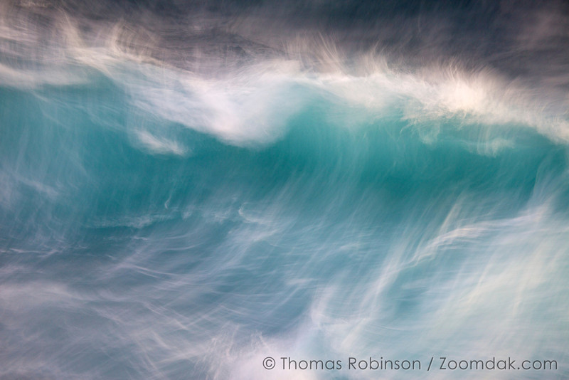 A half-second exposure shows the motion of foam and wave as it crests on the west shore of Kauai.