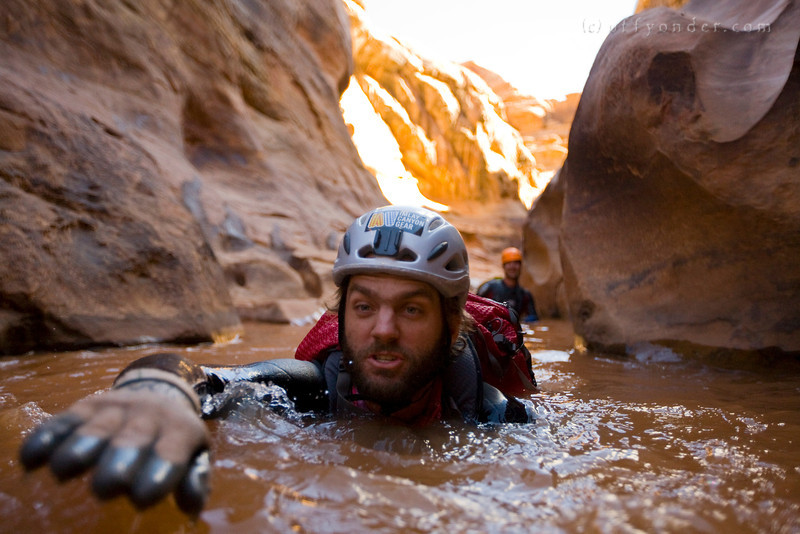 WHITE CANYON, UT - Canyoning through The Black Hole. Dan tries to keep his head dry.