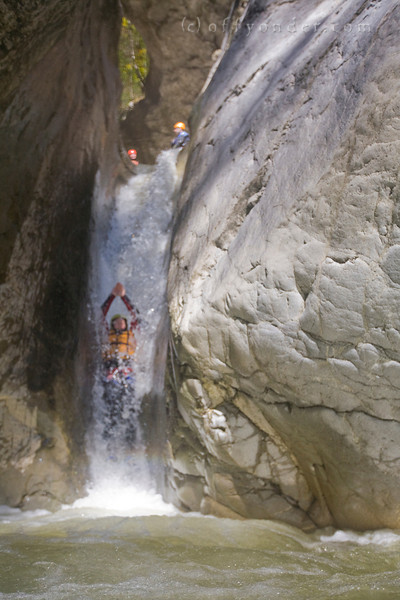 CHLI SCHLIERE, SWITZERLAND - Canyoning: Following a creek into a canyon and jumping, rapelling or sliding along with the water.