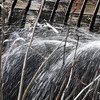 Water leaking from wooden penstock at hydro-power facility in Pepperell, Massachusetts, USA