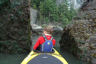 Amy checks out the exposed marine life as we pass through some slimy rocks at low tide.