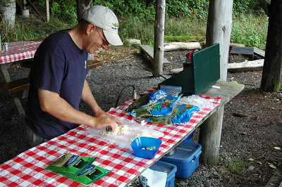 Jeff gets busy on dinner. Chopping garlic for pesto pasta.