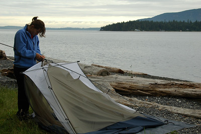 Day Three: Amy breaks down her tent as we get ready to pack everything back in the kayaks.