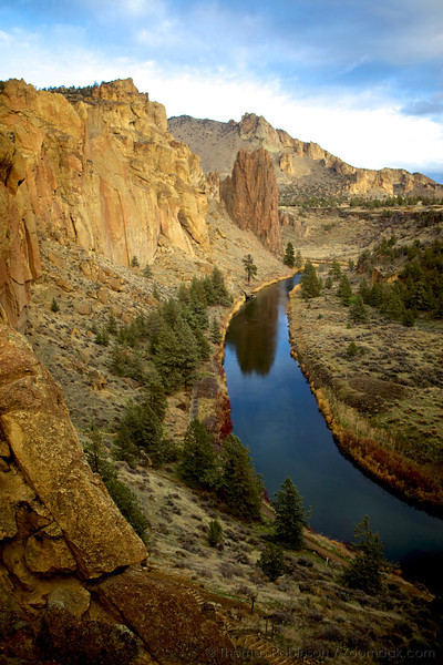 The Crooked River winds round Smith Rock State Park golden glow after sunset as seen from Asterisk Pass.