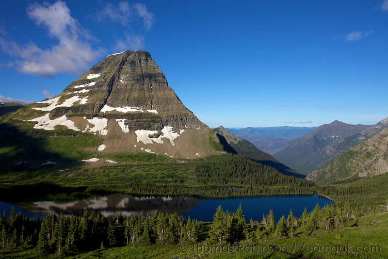 Bearhat Mountain (elevation 8684) reflects off Hidden Lake in the morning sun in Glacier National Park.