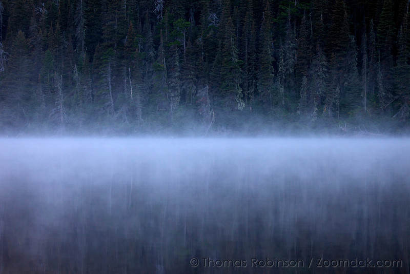 Mist rolls across Glenns Lake before sunrise. Morning mist, often called Steam Fog forms when cool air mixes with warm moist over water.