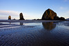 The low tide pools around Haystack Rock create textures in the sand and reflective surface of rock and sky.