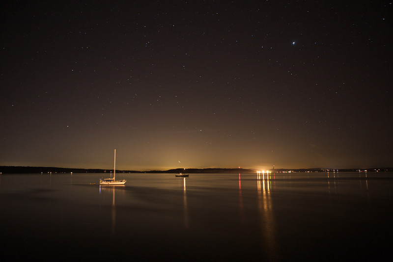 Stars glint in the sky over the Puget Sound.