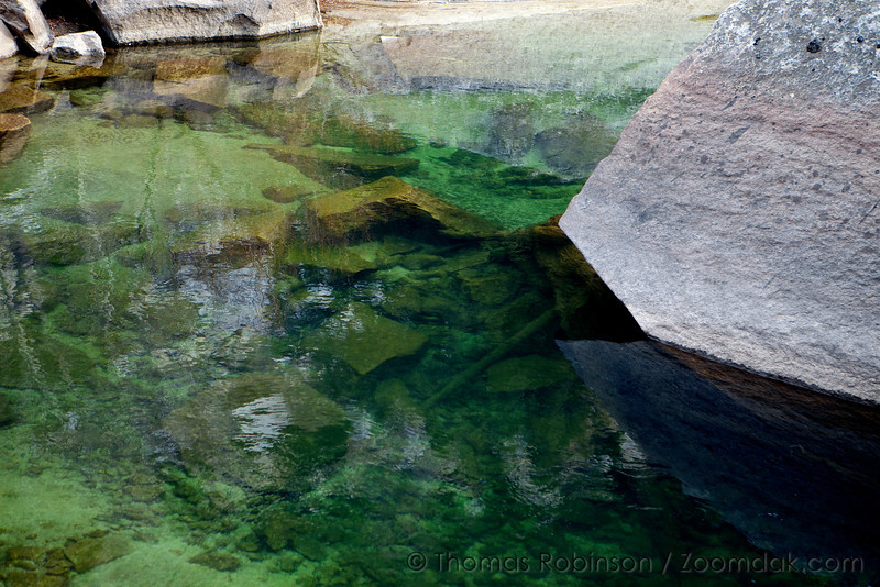 The still deep green pools of the Merced River as it floats through this granite rock garden.