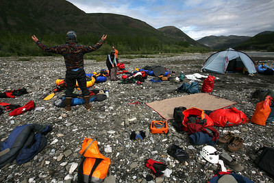 KONGAKUT RIVER, AK - Camp III: Drain Creek; Nathaniel throws his arms up at all the packing that needs to be done before we can get on the river.