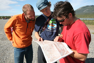 ARCTIC VILLAGE, AK - Sune and Nathaniel get some river beta from river guide, Matt, who is leading a commercial trip on the Kongakut.