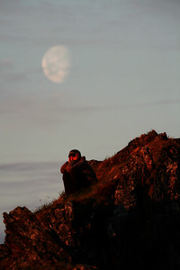 KONGAKUT RIVER, AK - Camp VII: Caribou Ridge; Lindsay taking some time to herself under the moon in the midnight sun.