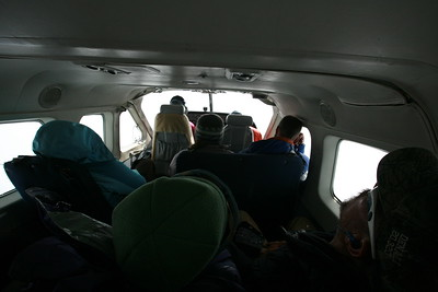 BROOKS RANGE, AK - Flying south over the mountains from Kaktovik to Fairbanks, many take this opportunity to take a nap.