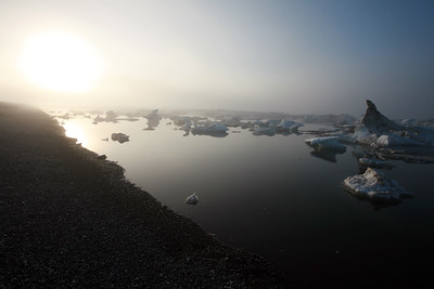 KONGAKUT RIVER, AK - Camp IX: Icy Reef; The late sun burning through the mist over the fragmented pack ice of the arctic ocean.