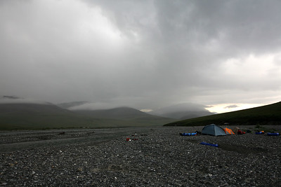 KONGAKUT RIVER, AK - Camp VI: Gateway; Exiting the mountains and heading to the costal plain, our camp at 5am after the clouds moved in.