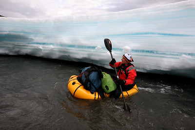 KONGAKUT RIVER, AK - Nathaniel manovers in his packraft past the ice along the side of the river.