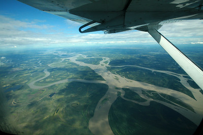 YUKON RIVER, AK - Flying south over the Yukon River and crossing the Arctic Circle heading for Fairbanks in a Cessna 208 Grand Carivan.