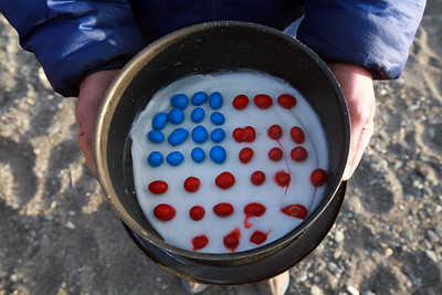 KONGAKUT RIVER, AK - Camp IX: Icy Reef; Sune and Lindsay make a Fourth of July dessert: coconut pudding with red and blue m&m's.