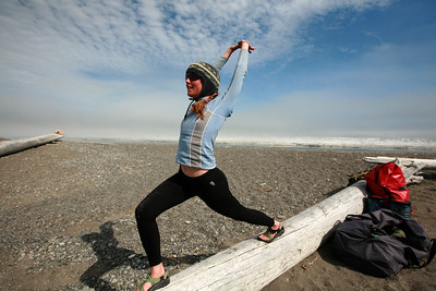 KONGAKUT RIVER, AK - Camp IX: Icy Reef; Lindsay takes some time to do some yoga on a log of driftwood.