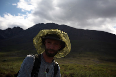 KONGAKUT RIVER, AK - Hiking around the headwaters, Sune is ready with his headnet to protect him from the bugs.