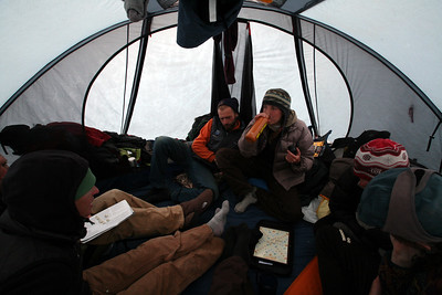 KONGAKUT RIVER, AK - Camp V: Canyon; On a rainy night, we all gather in the Lewis tent (palace) for a rousing game of team Scrabble.