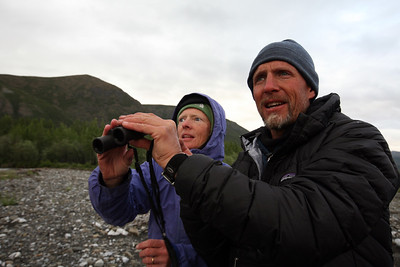 KONGAKUT RIVER, AK - Camp III: Drain Creek; Bobby hands Natalie the binoculars after spotting a new bird for the list.