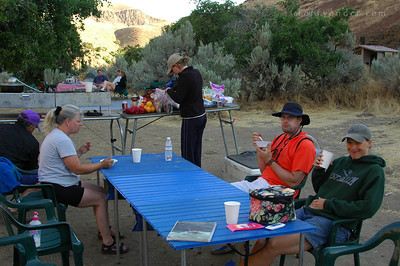 The next morning, a bright and chipper crowd gathers for their last breakfast on the river.