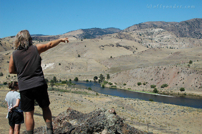 Dr. Taylor points out the massive land slide that came crashing down and may have dammed the river to form a lake, and eventually the Whitehorse Rapids that we are about to go rafting down.