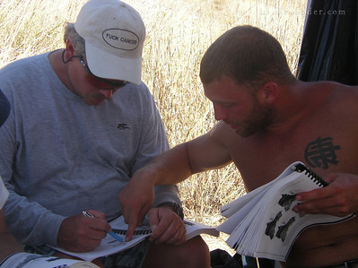 Roy and Mark take some time in the shade to study up.