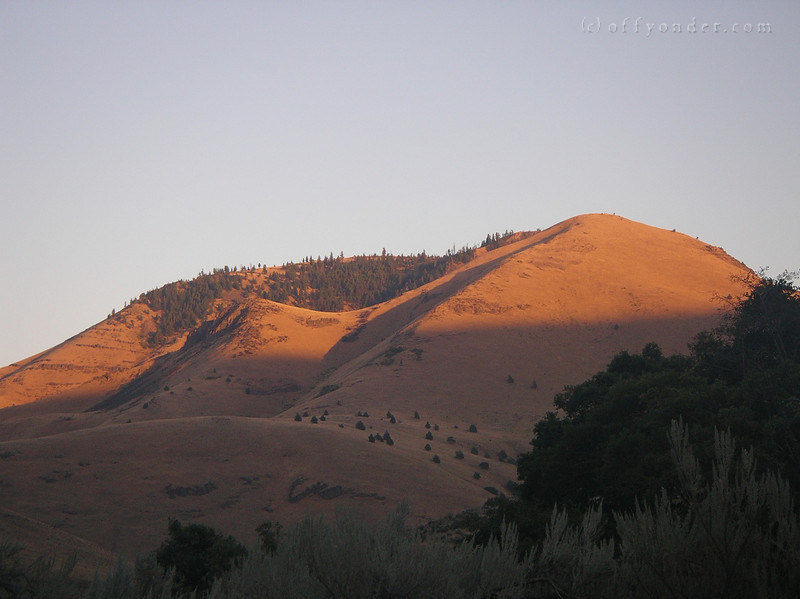 Eight O'clock rolls by and the last of the light is draped across these hills just up river from our camp.