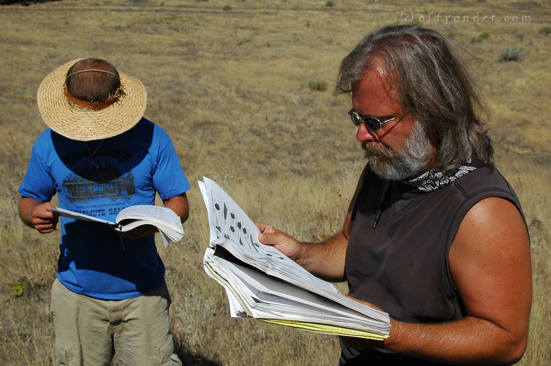 Dr. Taylor referes to his extensive field guide. Mark does well to keep up.