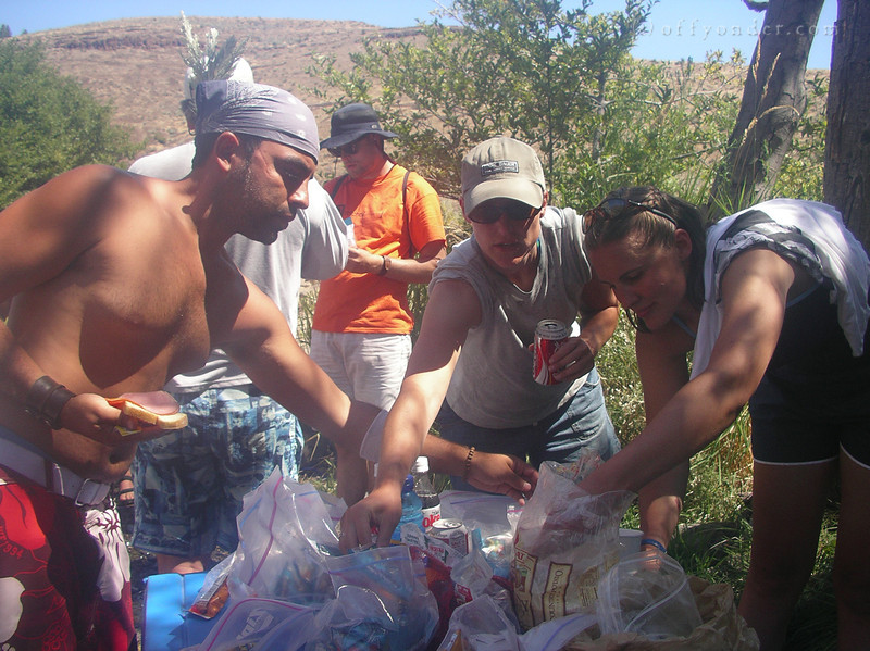The crew digs in for sandwiches.