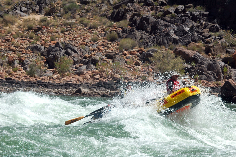 GRAND CANYON, AZ - Rich rides high as he and Max plow through the standing waves of Granite Rapid.