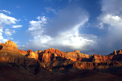 GRAND CANYON, AZ - The evening light brings out an impressive show of color from the cliffs forming the upper rim of the canyon.