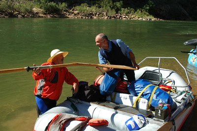 GRAND CANYON, AZ - Eddie (r) holds the oar he snapped with John while in Lava Falls Rapid just before they got flipped over by the incredible strength of the hydraulics in the rapid.