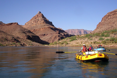 GRAND CANYON, AZ - The eighteenth day on the river, our last day, we spot Diamond Peak. Just around the bend we will pull out of the Colorado River and end our Grand Canyon trip. Max and Rich row side by side in the yellow raft.