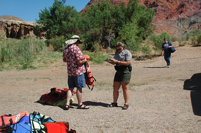 GRAND CANYON, AZ - Dan works with the ranger to get our life jacktes approved.