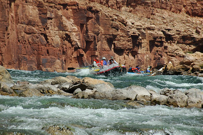 GRAND CANYON, AZ - Doug, Brian and John  come plowing down House Rock Rapid.