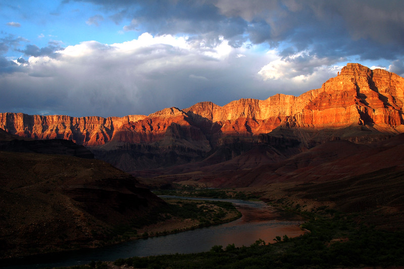 GRAND CANYON, AZ - The evening light brings out an impressive show of color from the cliffs forming the upper rim of the canyon. River mile 71 above Cardenas Camp (Camp V).