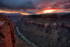 "The clouds hang over the Grand Canyon from the Tuweep / Toroweap Overlook at sunrise along the western side of the North Rim. The Toroweap Overlook stands 3000 vertical feet above the Colorado River. <br /> <br /> 'Tuweep in Paiute refers to ""the earth,"" but this place name may be derived from a longer Paiute word meaning ""long valley.""'<br /> - <a href=""http://www.nps.gov/grca/planyourvisit/tuweep.htm"">http://www.nps.gov/grca/planyourvisit/tuweep.htm</a>"