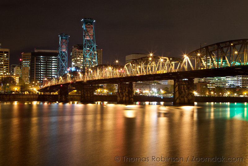 The Steel Bridge stands above the Willamette River in Portland, Oregon.
