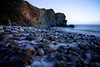 The outflow of Limekiln Creek meets the ocean in Limekiln State Park, along the Big Sur coastline in California.  The rocky cliffs come to a point that looks like a witch overlooking the ocean.