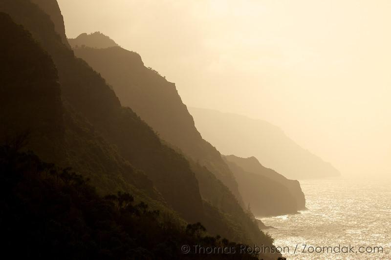 The ridges of the Nā Pali coast cascade into Pacific Ocean on the northwest shore of Kauai.