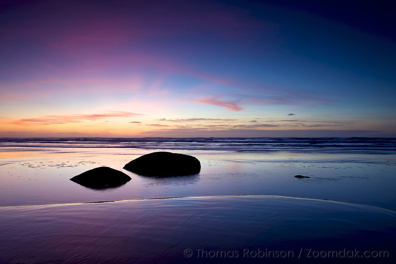 Be at peace. Two beach rocks rest in the tide pools of Hug Point luxuriating in the evening glow.